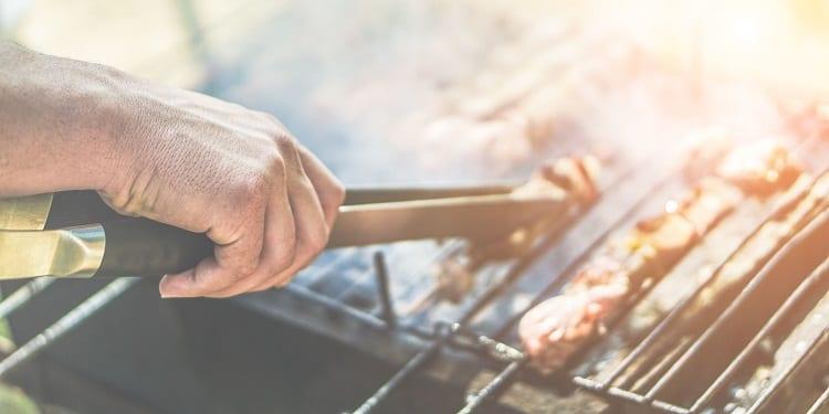 BBQ Utensils In Hand
